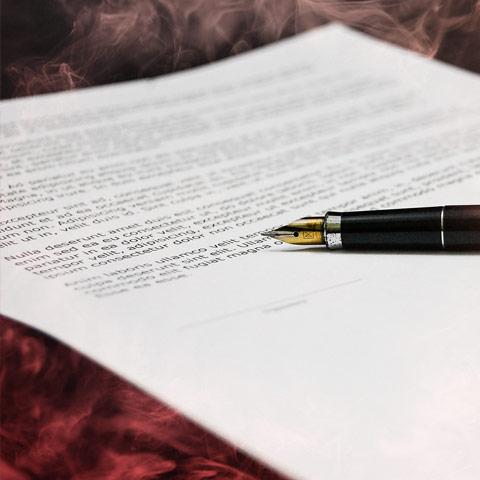 Hazy cigarette smoke around paper document