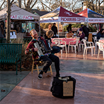 Musician playing in Outdoor Restaurant Patio
