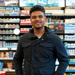 Man behind convenience store counter