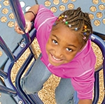 Girl on play equipment