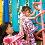 Mother and child on play equipment