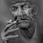 Elderly man smoking cigarette