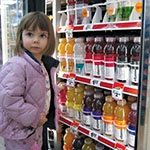 Kid Shopping for Vitamin Water