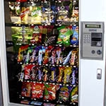 Vending machine with snacks and sugar sweetened beverages